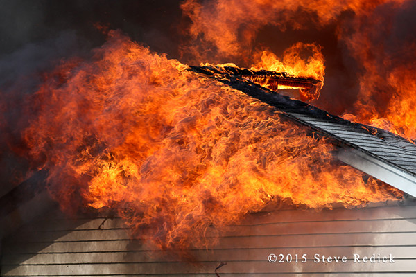heavy flames at house fire