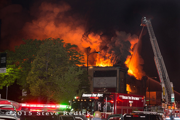 bowling alley on fire at night