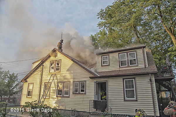 brown smoke from roof of a house fire