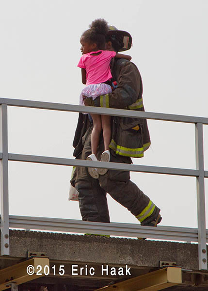 fireman carries young girl to safety