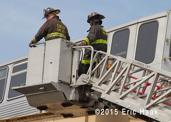 Chicago firemen in tower ladder basket