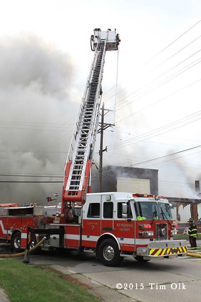 Sutphen aerial ladder working at large fire scene
