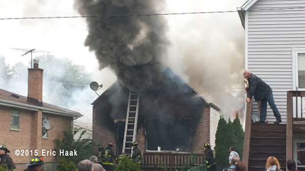 thick black smoke billow from house after fire