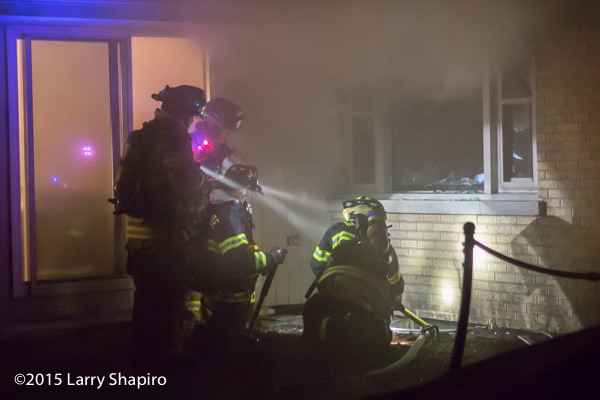 firefighters immersed in smoke at night