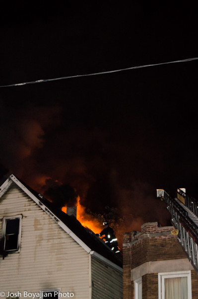 Chicago firemen on roof with heavy fire at night