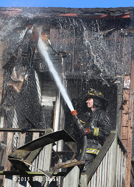 firefighter washing down after fighting a fire
