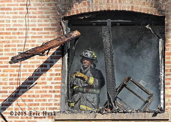 firefighter overhauling after fighting a fire