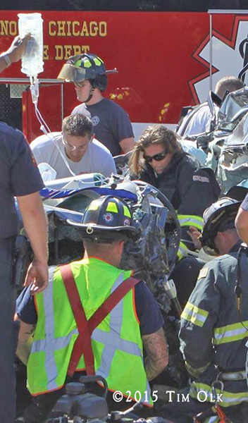 firefighters work to free a driver trapped after a crash