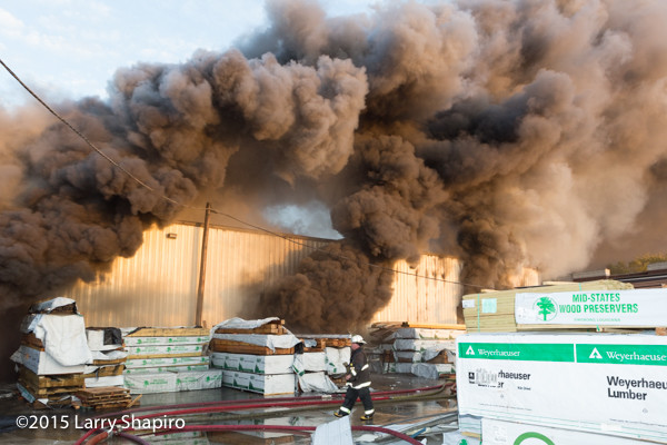 heavy black smoke pours from Chicago lumber yard on fire