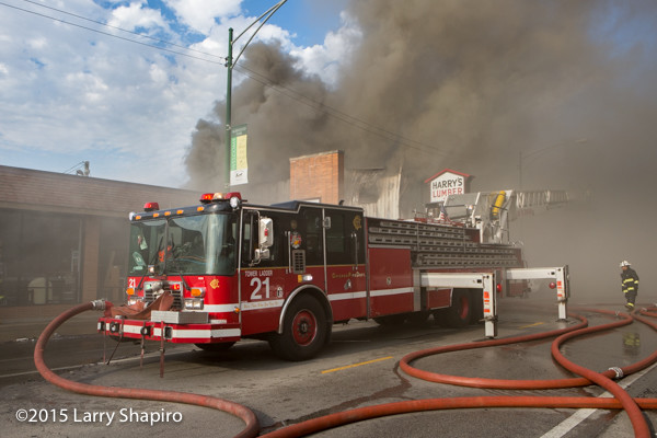 Chicago FD HME LTI tower ladder working at a fire