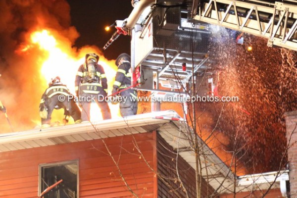 Stuffed tower ladder operating at a night fire in Hartford