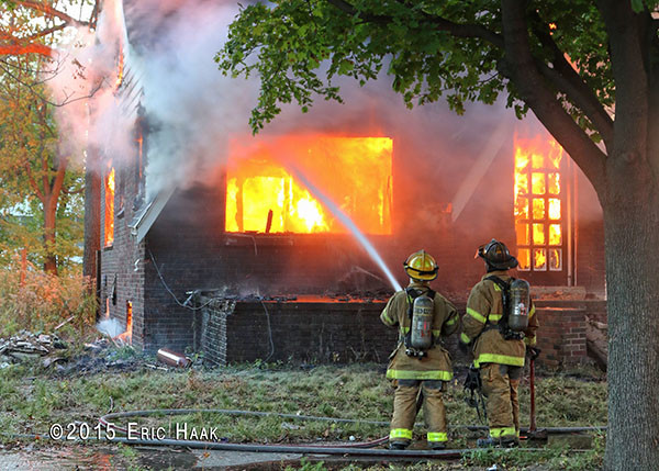 fully engulfed vacant house  fire