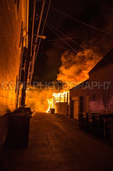 detached alley garage engulfed in flames