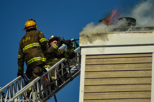 firemen working from an aerial ladder