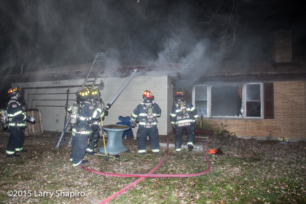 firefighters at night fire scene
