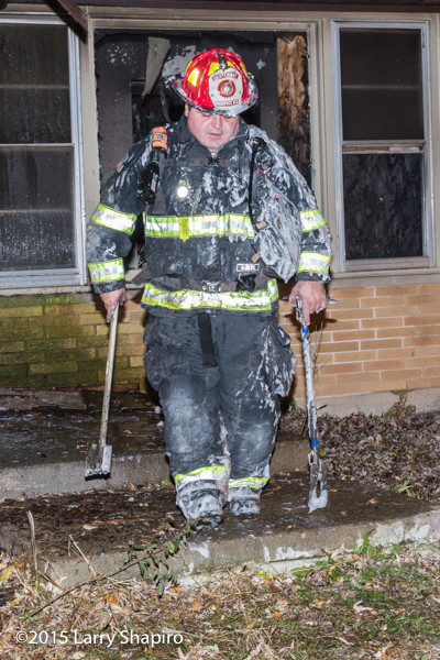 firefighter covered with foam
