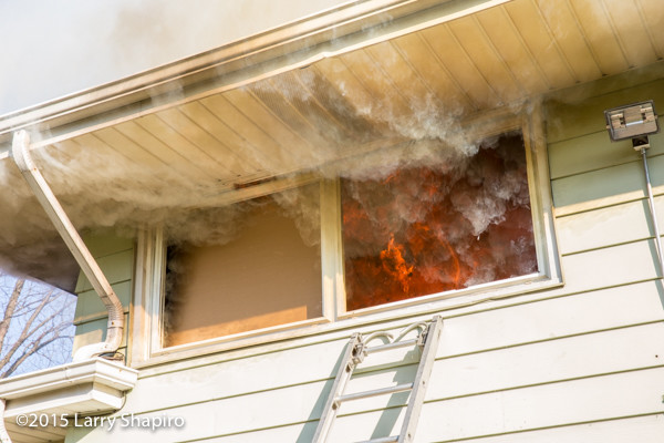 flames blowing out 2nd floor window