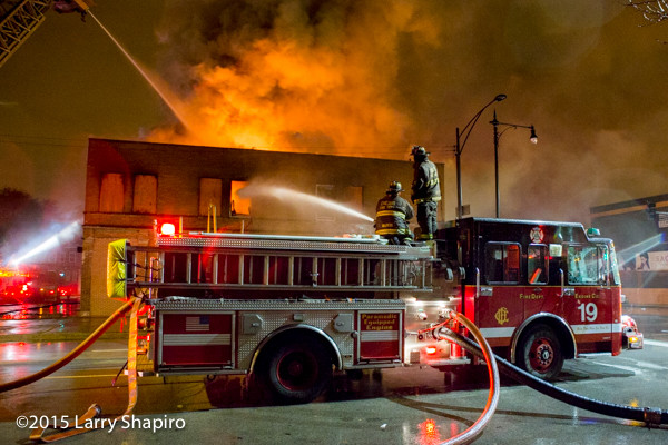 Chicago Spartan fire engine using deck gun at fire scene