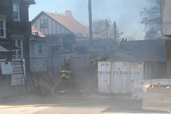 dumpster fire at construction site