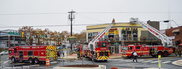 fire trucks aFirefighters from the Montgomery County Fire & Rescue Department at a commercial fire scene in Wheaton, MD 11/5/15. Trevor James photot fire scene in Wheaton MD