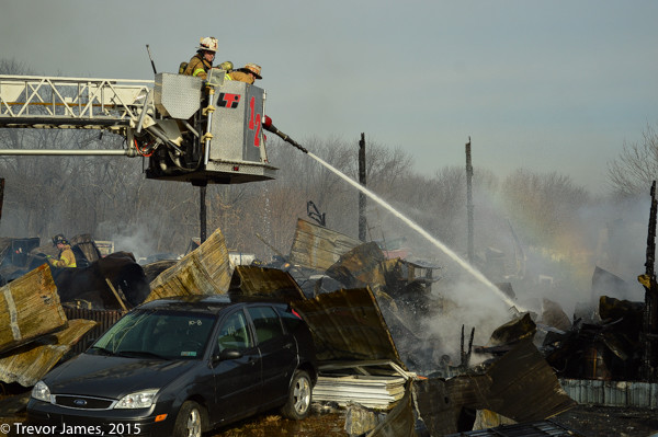 firefighters overhaul after large fire