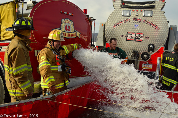tanker dumps water at fire scene