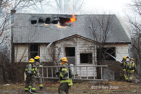 firefighters extinguish fire in a vacant house