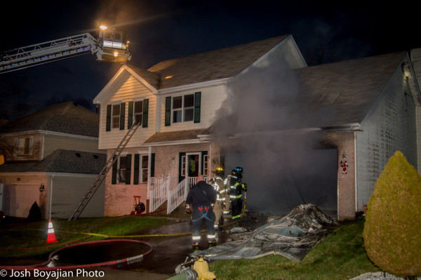 fire in the attached garage of a house