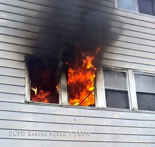 flames blowing out of a window