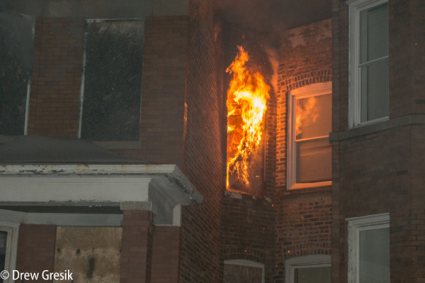 fire blows out window at night