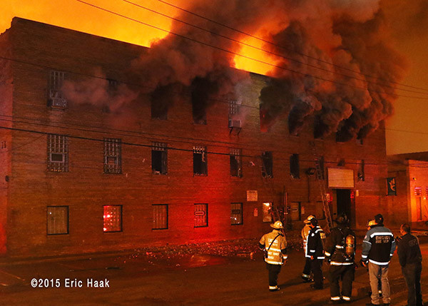 massive building fire at night in CHicago