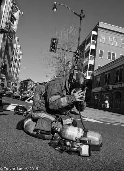 firefighter dons SCBA mask