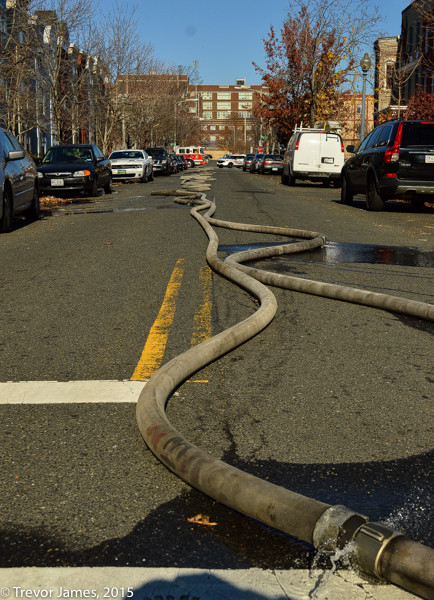 hose on the street at fire scene