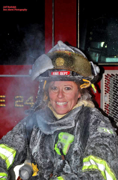 female firefighter covered with ice at fire