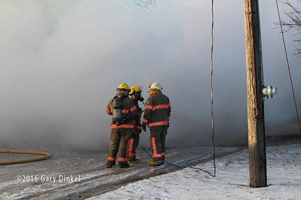 Canadian firefighters battle fire and frigid temperatures
