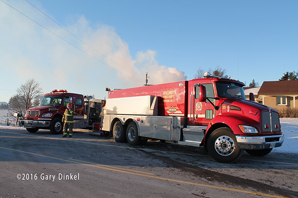 rural water supply and tanker shuttle at barn fire in Canada
