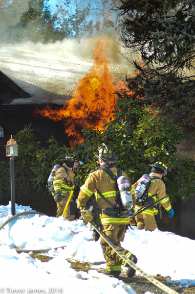 firemen battle house fire in the snow