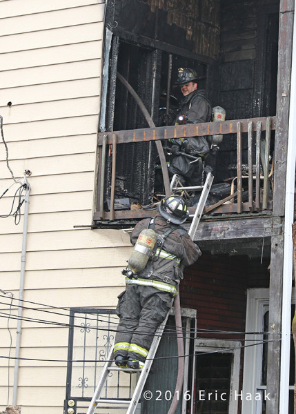 Chicago firefighters after battling a rear porches fire