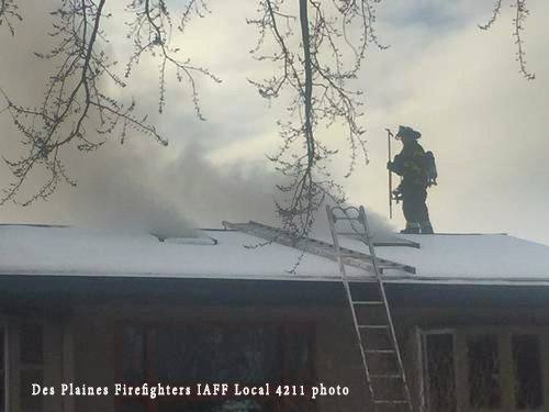 firefighters battle a winter house fire