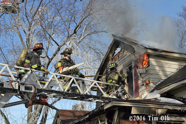 firefighters overhaul from ladder tip