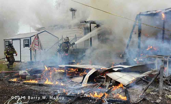 firefighters overhaul after doublewide mobile home fire
