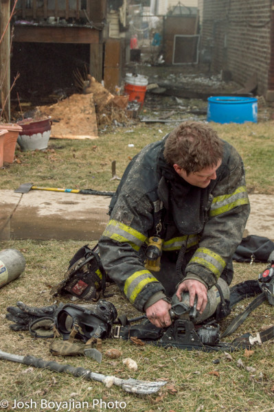 firefighter changes air bottle at fire