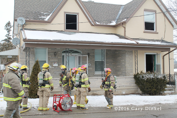 firefighters at a Elmira Ontario house fire scene