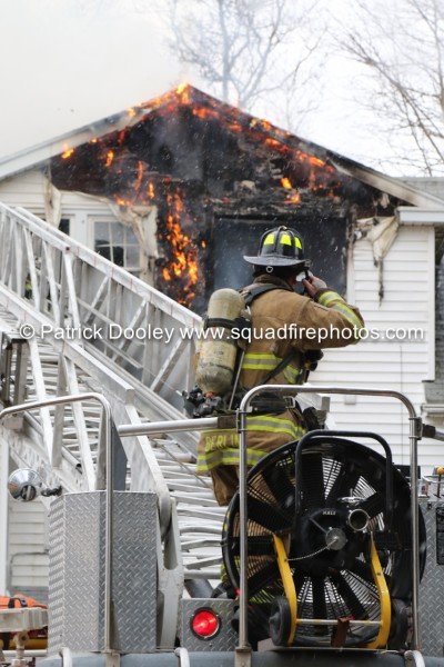 fireman at aerial ladder base