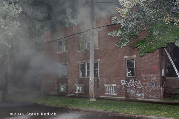 heavy smoke from a two-story building