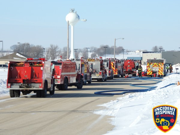 fire trucks staged at fire scene
