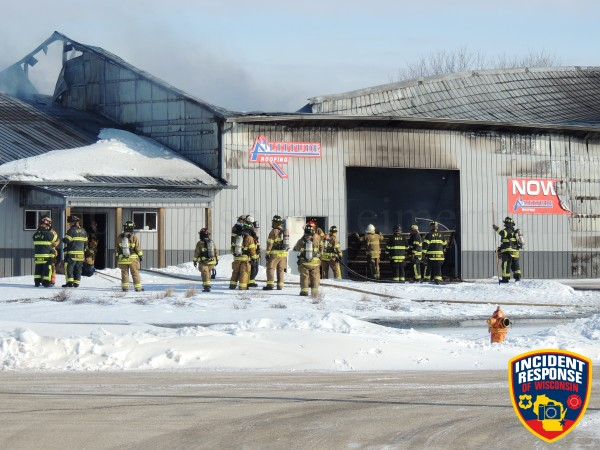 firemen at commercial fire scene in WI