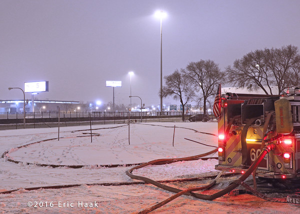 fire hose in the snow at scene