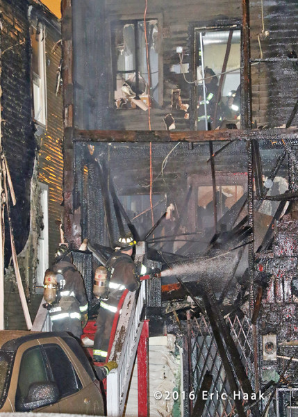 firemen overhaul back porches fire in Chicago