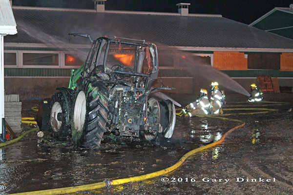 tractor destroyed by fire with barn